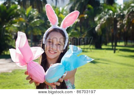 Smiling Cute Teen Girl With Rabbit Ears Holding Easter Chocolate Eggs