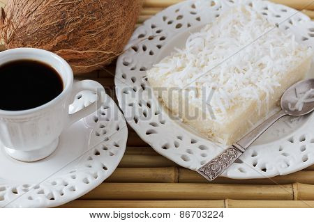 Brazilian Dessert: Sweet Couscous Pudding (cuscuz Doce) Coconut On White Vintage Plate With Cup Of C