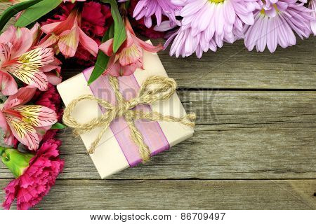 Gift box with flower border on wood