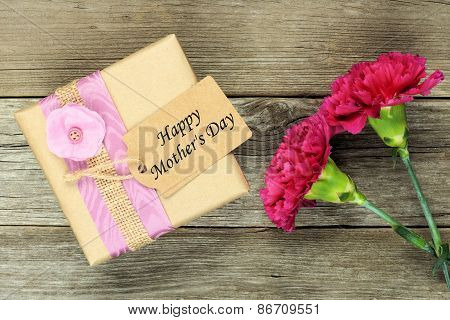 Mother's Day gift with carnations on wood
