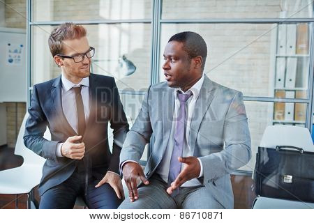 Two male colleagues planning work or consulting