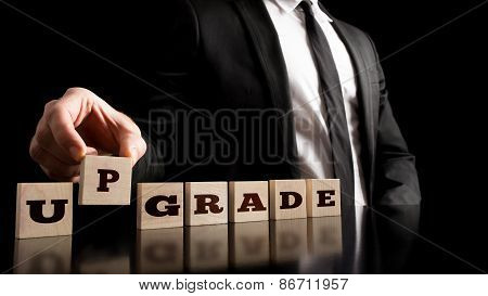 Businessman Arranging Blocks For Upgrade Concept