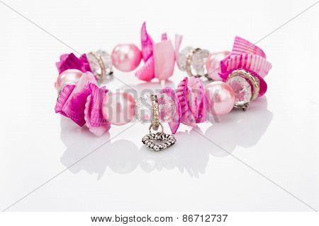 pink bracelet with pendants