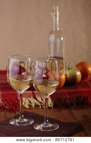 Wineglasses, Bottle And Fruits