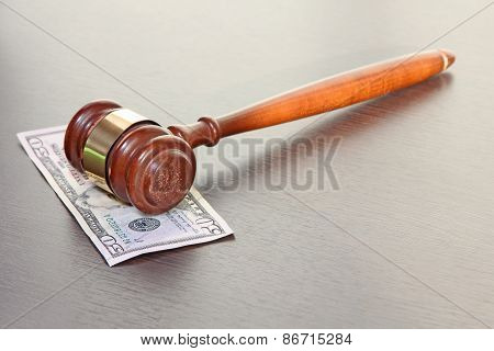 Judge Gavel With Fifty Dollars Banknote On Wooden Table.