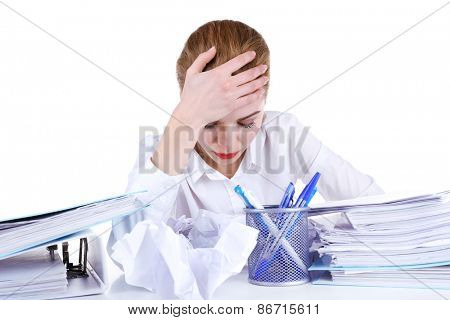 Tired woman at her workplace with documents isolated on white