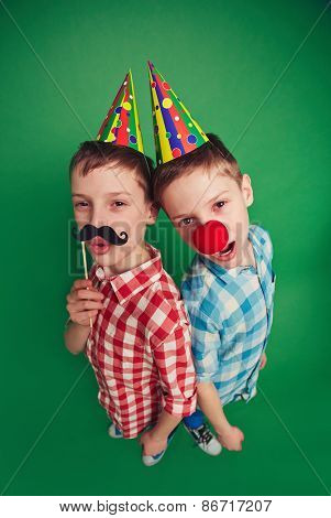 Cute twin brothers celebrating fool�¢??s day