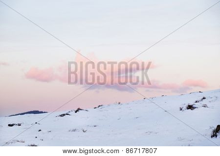 Cloudy sky over snowdrift