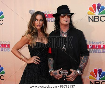 LOS ANGELES - MAR 29:  Courtney Bingham, Nikki Sixx at the 2015 iHeartRadio Music Awards at the Shrine Auditorium on March 29, 2015 in Los Angeles, CA