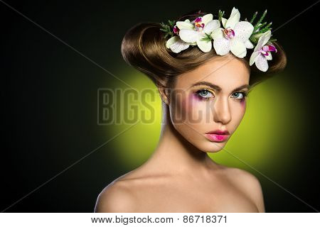 Portrait Of A Beautiful Woman With Orchids Flower In Her Hair.