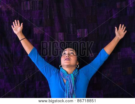 Hispanic woman arms raised