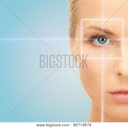 health, medicine, identity, vision and people concept - beautiful young woman with laser light lines on her eye over blue background