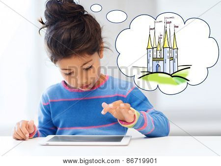 technology, childhood, entertainment and imagination concept - little girl playing with tablet pc computer and thinking about fairytale castle at home