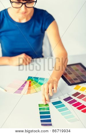interior design, renovation and technology concept - woman working with color samples for selection