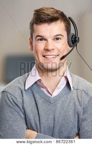 Portrait of confident male customer service representative in corporate office