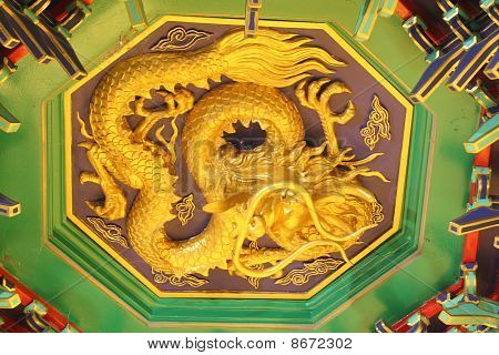 A golden dragon in chinese style. On ceiling.