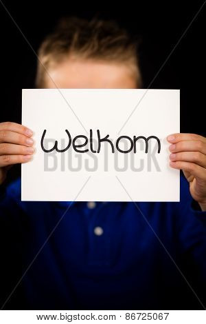 Child Holding Sign With Dutch Word Welkom - Welcome