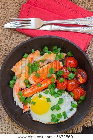 Fried eggs with crab meat, tomatoes and green onions