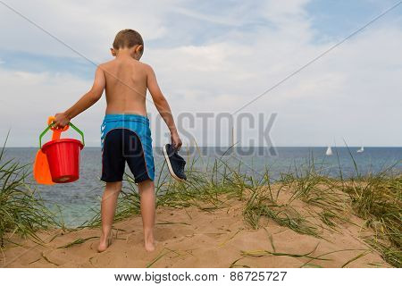 Young Boy With Plastic Bucket