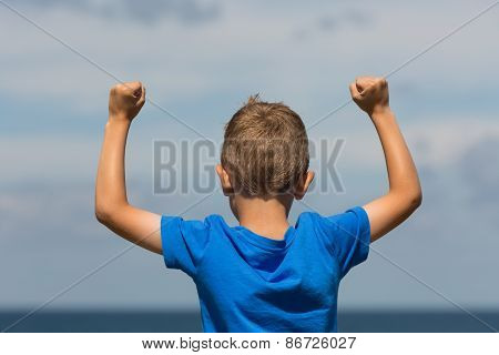 Boy With Clenched Fists