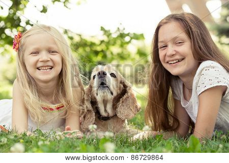 Two Girls With Dog