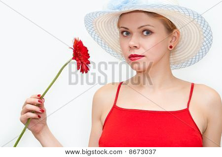 Portrait Of The Girl In A Straw Hat And A Red Flower