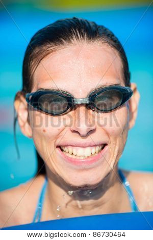 Young woman in goggles at swimming pool