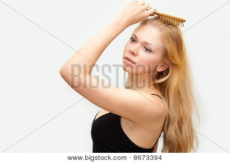 Girl Combs Hair