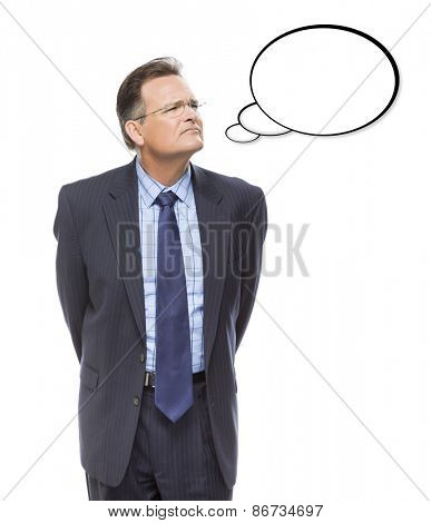 Pensive Businessman Looking Up And Over At Blank Thought Bubble Isolated on a White Background.