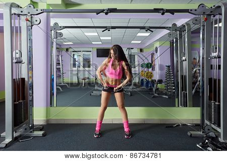 Image of sexy woman training with expander in gym
