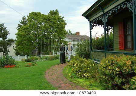 Couple walking in a Victorian Garden