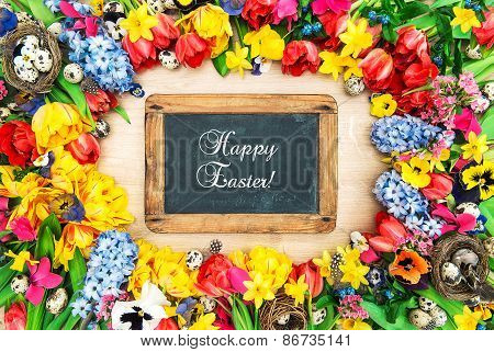 Spring Flowers And Easter Eggs. Holidays Background Chalkboard