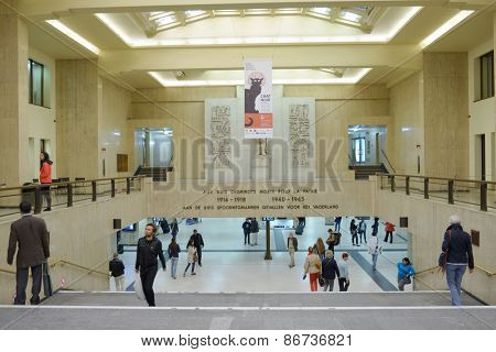 BRUSSELS, BELGIUM - JUNE 24, 2013: People in the central train station. Built in 1952, the station has six tracks, served by three underground platforms