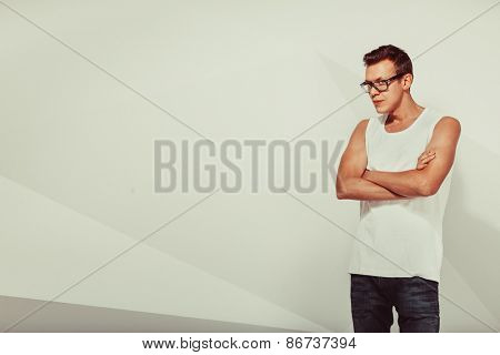 Portrait of serious cute man over vintage background