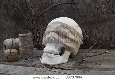 Skull branches and thread.
