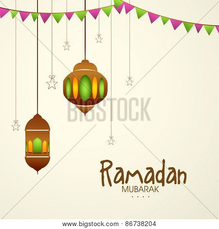 Hanging traditional lanterns on beige background for or Islamic holy month of prayers, Ramadan Mubarak celebrations.