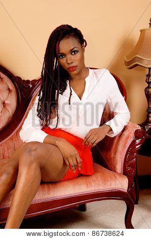 African Woman Sitting On Couch.