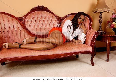 Pretty African Woman On Couch.