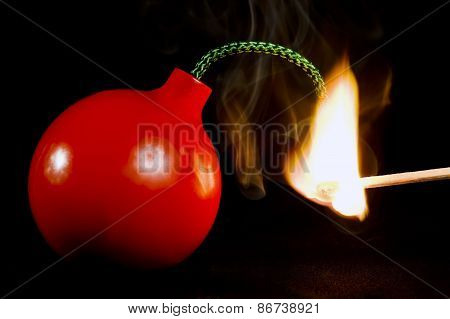 Flaming Match Lighting A Bomb