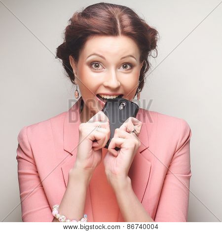 young funny businesswoman with mobile, studio shot
