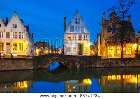 Night Bruges canal with beautiful colored houses