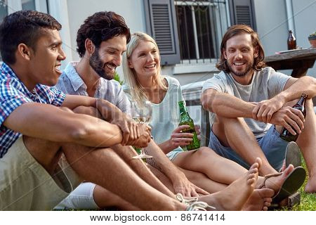 happy smiling diverse group of friends having outdoor garden party with beer wine drinks
