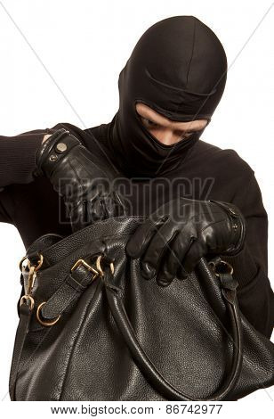 Thief stealing money from women handbag. Isolated on white background