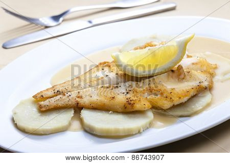 fried halibut with sweet potatoes and lemon sauce