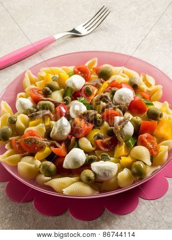 cold pasta salad with mozzarella tomatoes capers and anchovies