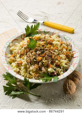 couscous with bacon carrot dried grape and nuts