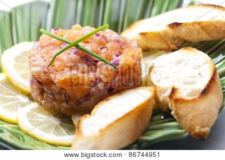 salmon tartar with red onion