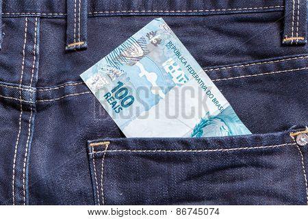 100 Brazilian Reais on the jeans pocket