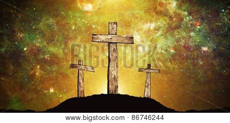 Three wooden crosses and background from space with stars and sunlight. Elements of this image furnished by NASA