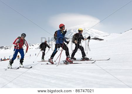 Ski Mountaineers Climb On Skis On Mountain. Team Race Ski Mountaineering. Russia, Kamchatka